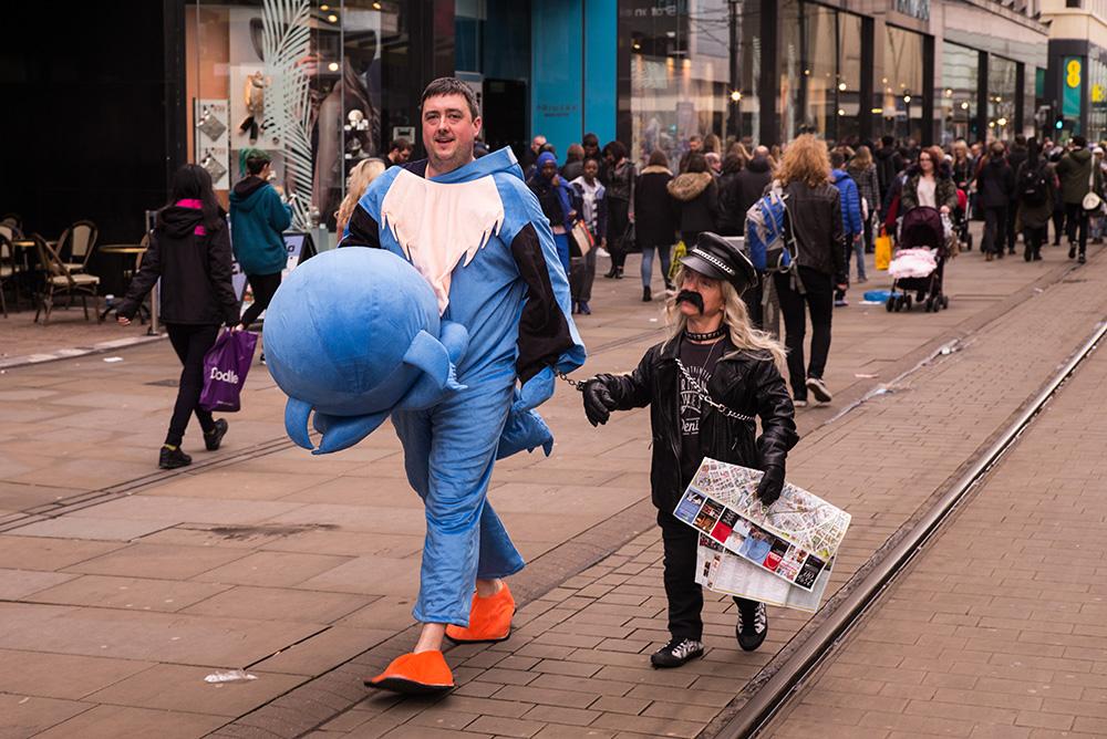 Fancy-dress-on-Market-Street-Manchester-Les-Telford